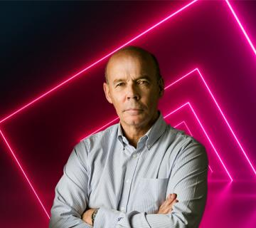 sir clive woodward with neon pink squares on black background